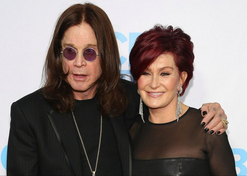 Picture of Ozzy Osbourne with his arm around Sharon Osbourne